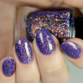 "Nail polish - ""Another Icon"" A purple base filled with orange / green flakes"