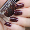 "Nail polish - ""Gravity Drive"" A dark brown with gold glitter"