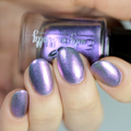 "Nail polish - ""Limerick"" A pale grey base with purple to gold shifting shimmer"