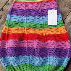 crocheted baby sleeping or pram cocoon. Rainbow colours cotton and acrylic