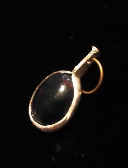 Solid black Walo Opal set in fine silver pendant