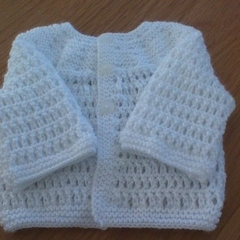 White Round Necked Baby Cardigan to fit 0 to 3 months.