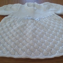 BABIES WHITE DRESS IN ACRYLIC TO FIT 0 3 MONTHS.