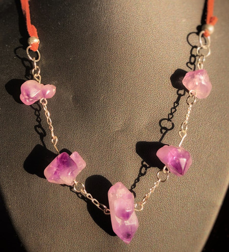 Genuine uncut Amethyst, silver and leather necklace.