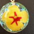 Miniature Yellow Hibiscus in a Domed Pendant,  Opal Background,  Fine Gold Chain