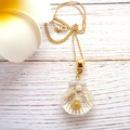 Shimmering White/Gold Shells In a Resin Scallop Shell Pendant, Fine Gold Chain
