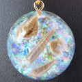 Tiny Gold Polymer Clay Shells in an Iridescent Opal Domed Resin Pendant