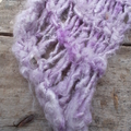 Open knit scarf made from banana fibre yarn in mauve. spring or autumn accessory