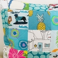 Beach holidays patchwork cushion.  Caravans, surfie puppies and pineapples.