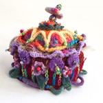 Unique whimsical 4-6 cup crochet tea cosy with colourful embellishments.