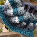 Crocheted winter hat. Pure wool with open work. Teal, grey and white