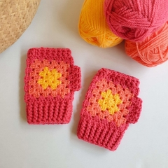 Kids crochet wrist warmers/fingerless gloves.