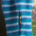 child's hand crocheted leggings. cotton and cotton blend yarns. blue and white
