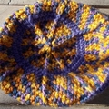 Infant's crocheted cap in bright acrylics, purple and yellow. ON SALE!!!!