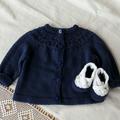 Dark navy cotton cardigan, size 00.  Circular yoke. long sleeves