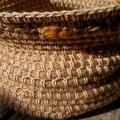 Crocheted basket made from jute, cotton and wool.