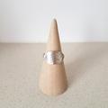 Unisex silver cigar style ring, planishing texture  size AU O 1/2