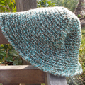 child's crocheted brimmed hat, wool. Blue, white and olive green.  Sun safe