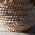 Crocheted pot made from jute, cotton and wool.