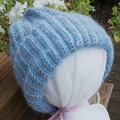 Pretty blue crocheted hat with ponytail opening