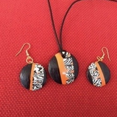 Black, orange and white tribal design. Earrings and matching pendant.