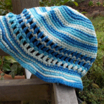 Crocheted summer hat, blues with brim. 100% cotton.