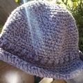 crocheted summer hat with brim made from cotton/acrylic blend yarn in purple