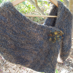 Multi-wear stole made from soft acrylic yarns with crocheted brooch