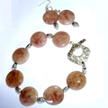 Dusky pink bracelet and earrings in silver and crystal