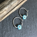 Evil eye charm with inlaid Mother of Pearls sterling silver earrings.