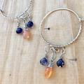 Peach Moonstone and Iolite hoop earrings in sterling silver.