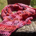 Crocheted shawl made from pink and purple wool/soy yarn, versatile accessory