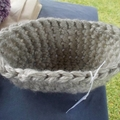 Oval shaped crocheted bowl made from off white acrylic yarn