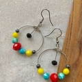 Fun fiesta style handmade hoop earrings.
