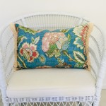 Boho floral linen cushion cover with cotton fringing.