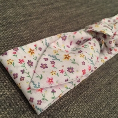 White and floral kids size cotton tie-up headband with elastic back