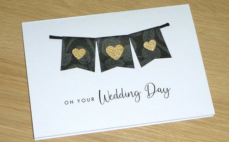 Wedding day card - black bunting with gold hearts