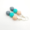 Turquoise, peach and grey round bead dangle earrings.