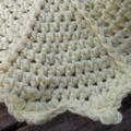 Round crochet washcloth in yellow bamboo fibre