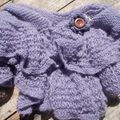 Knitted shoulder or hip wrap made from mohair blend yarn with button brooch
