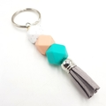 Small tassl keyring in turquoise, peach, marble silicone beads with grey tassel