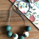 Handmade polymer clay beaded necklace | jungle green and beige with mixed polka
