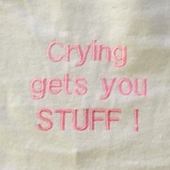 Crying gets you stuff embroidered bib
