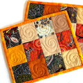 Set of 2 Aboriginal fabric patchwork quilted mug rugs, orange cream brown mats