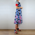 Wrap A-Line Pinafore Dress in a Raindrops Print with Hand Screened Pink Flowers