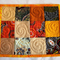 Set of 2 Aboriginal fabric patchwork quilted mug rugs, orange cream brown mats