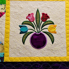 Colourful patchwork and flower applique quilted table runner or wall hanging