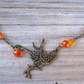 Bronze Bird of Peace Necklace with Orange/Amber Crystal Beads