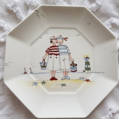 Handpainted on a Wedgwood bone china plate a seaside scene.