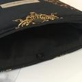 Black velvet padded book sleeve.